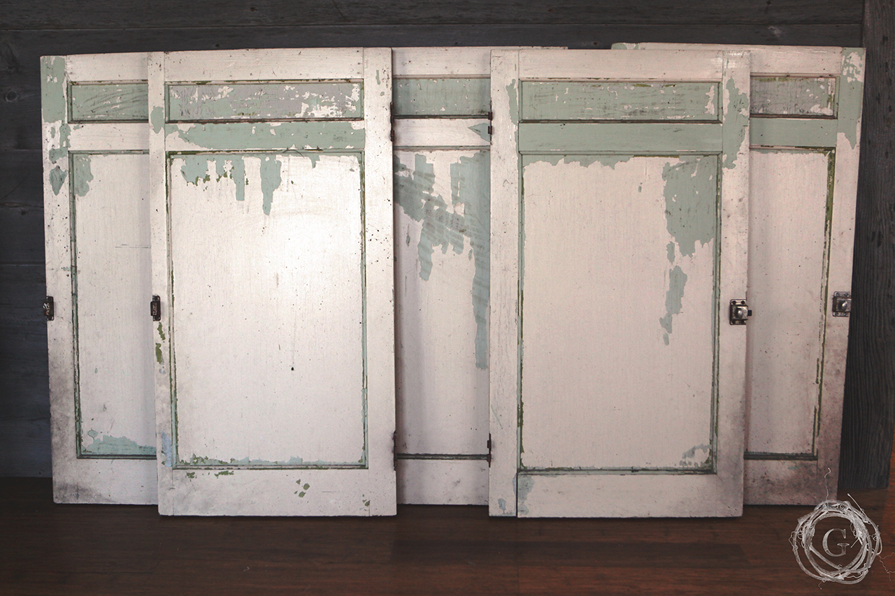 Antique kitchen cabinets with weathered paint and old hardware